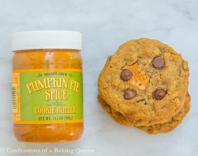 Pumpkin Chocolate Chip Cookie Butter Cookies next to a pumpkin pie spice cookie butter jar on white marble surface