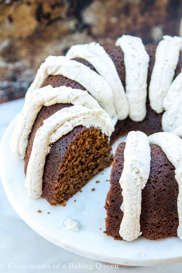Guinness gingerbread cake with brown butter frosting served on a marble cake stand