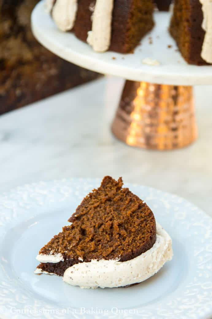 Guinness Gingerbread Cake on a blue plate with cake stand and full plate in the background