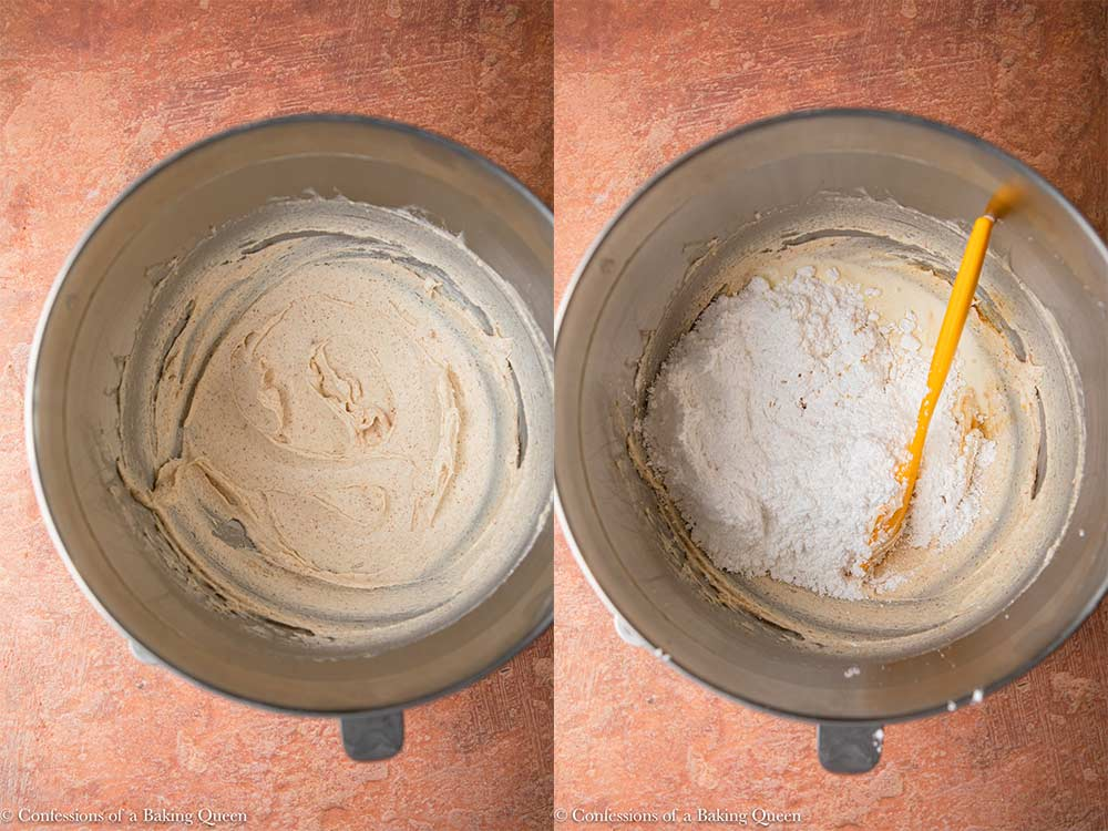powdered sugar, vanilla, and heavy cream added to cream cheese butter mixture in a metal bowl on a reddish brown surface_