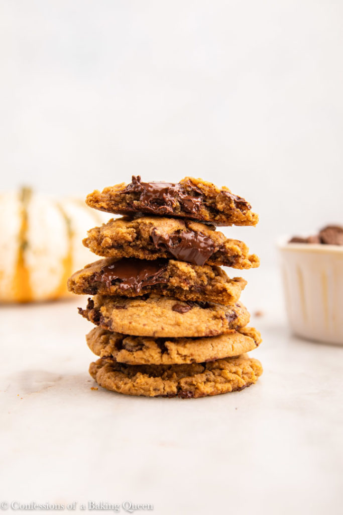 stack of pumpkin chocolate chip cookies on a marble surface