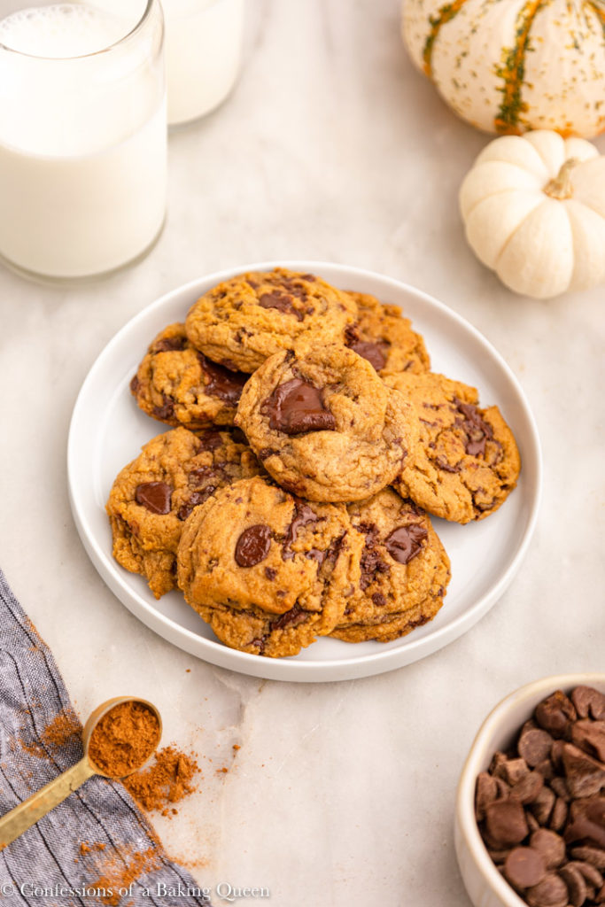 chewy pumpkin chocolate chip cookies on a white plate