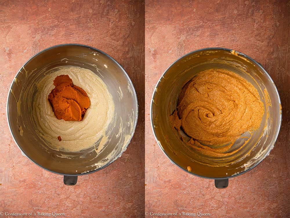 pumpkin puree mixed into wet ingredients in a metal bowl on a reddish brown surface