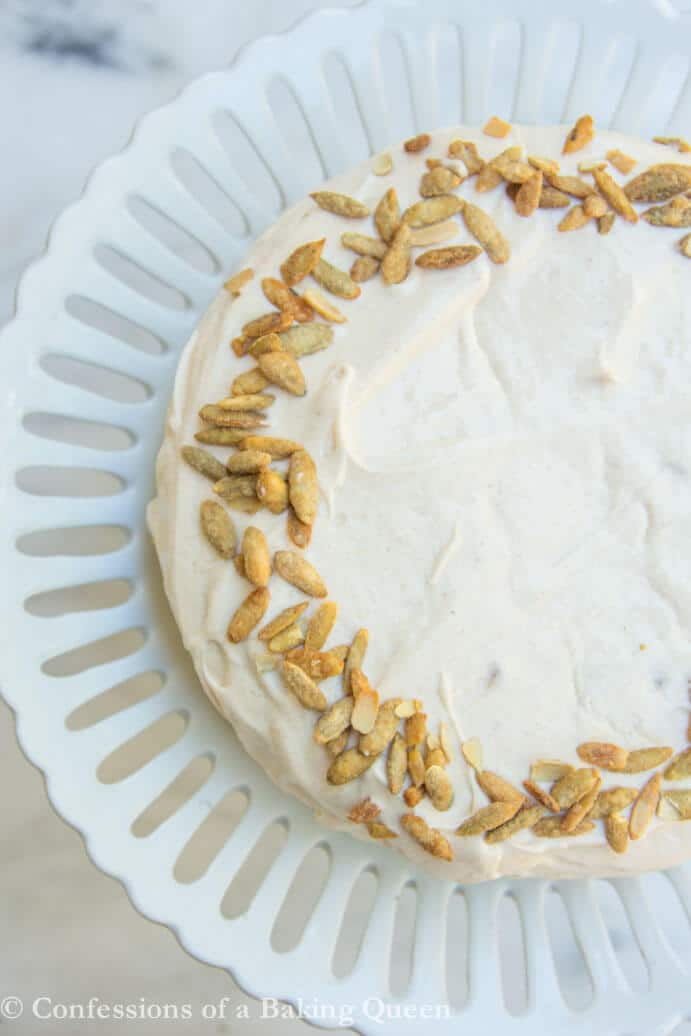 Easy Brown Butter Pumpkin Cake Recipe on a white cake plate on a white marble background