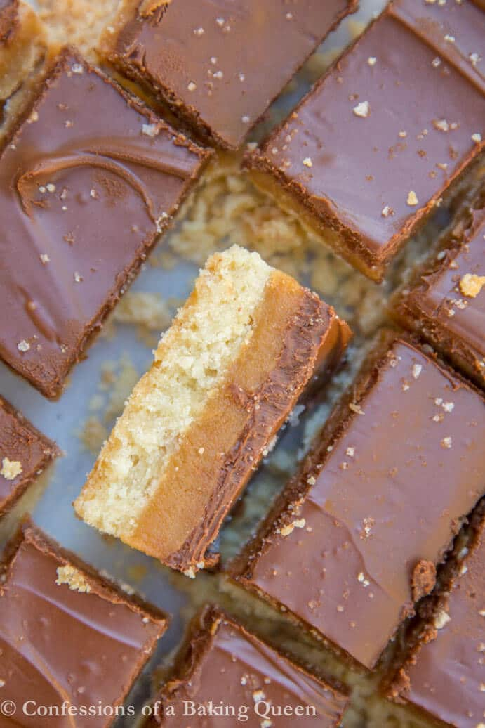 salted millionaire shortbread pieces with one sticking up to show the layers