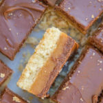 Salted Millionaire's Shortbread Recipe on a white board with one piece sitting on it's side