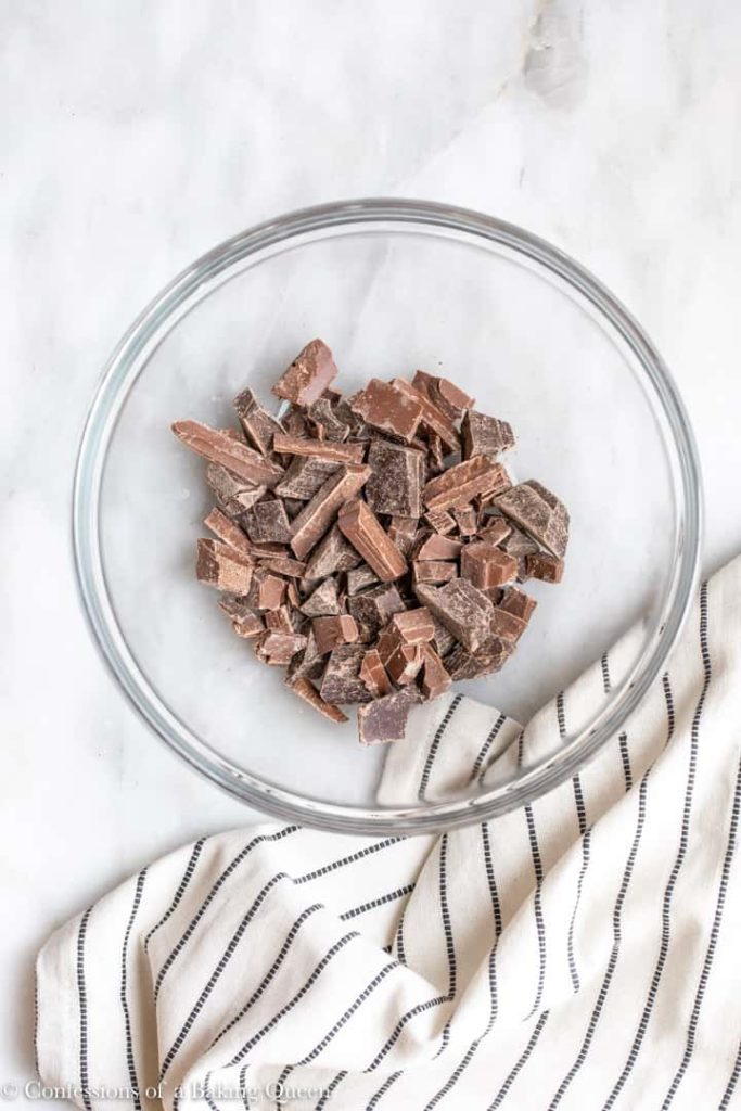 chocolate chopped up in a small glass bowl
