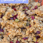 christmas granola baked on a silpat lined baking sheet