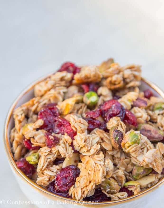 up close shot of Christmas Granola in a small bowl with gold lining