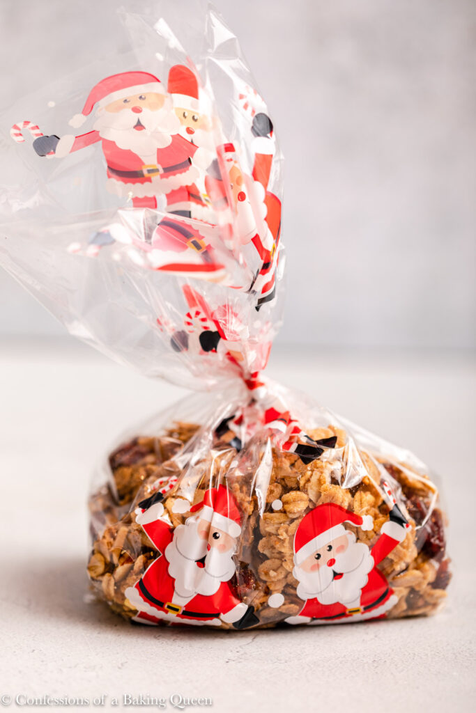 cranberry pistachio granola packaged in a Santa clear bag on a light grey surface