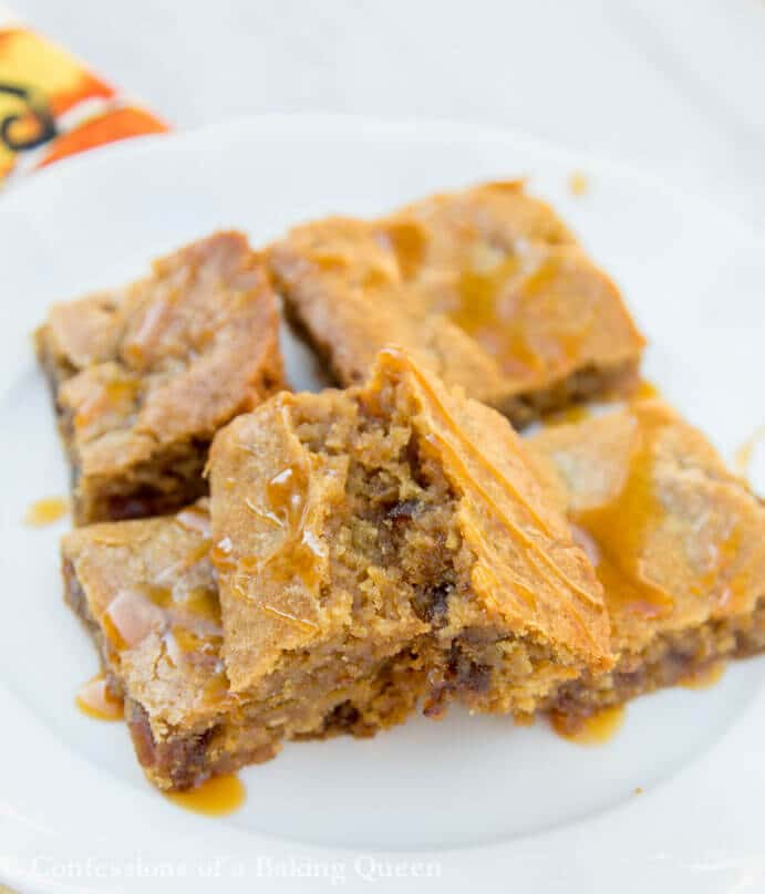 Sticky Toffee Pudding Blondies broken in half to show the insdie stacked on top of each other