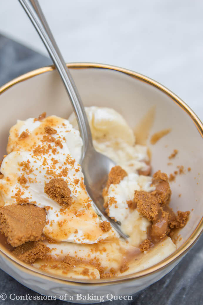 Deconstructed Banana Cream Pie in a cream bowl with a silver spoon getting a bite