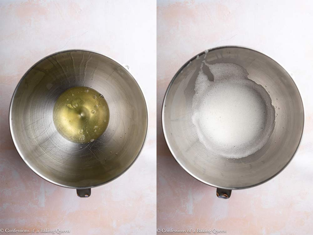 egg whites whisked together until foamy in a metal bowl on a pink surface