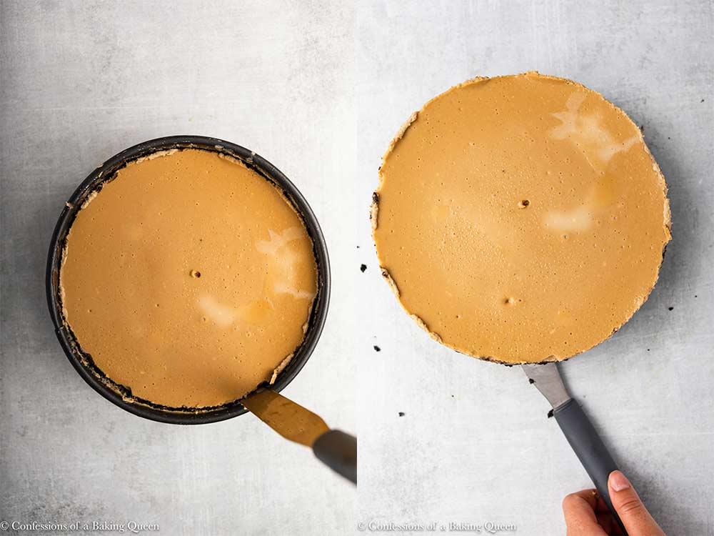 spatula loosening cheesecake from the springform pan on a grey surface
