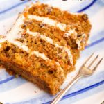 slice of carrot cake on a blue plate