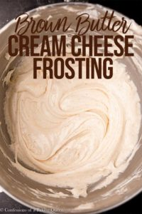 browned butter cream cheese frosting in a metal bowl