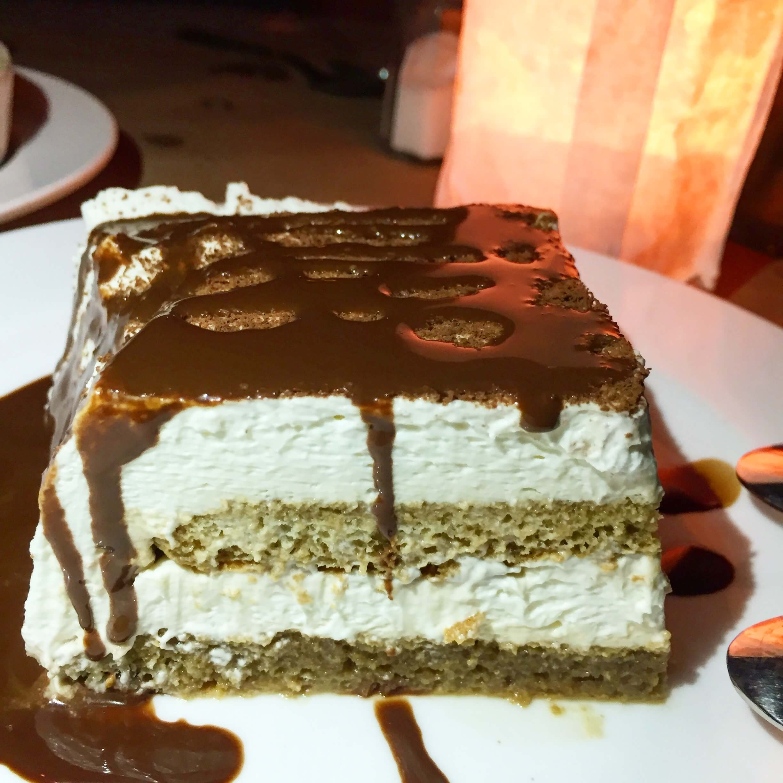 slice of tiramisu on a white plate from maltessa in new york
