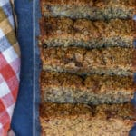 Oat Flour Skinny Banana Bread on a dark surface next to an orange and white checkered linen