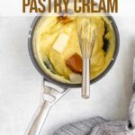 butter, vanilla extract, and dulce de leche added to pastry cream in a small saucepan on a grey background with a blue linen