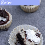 mini oreo cheesecakes on a dark grey background with one cheesecake missing a bite on its side