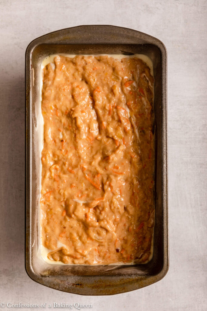 carrot pineapple banana loaf cake before baking on a light grey surface