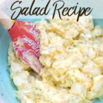 Classic Homemade Egg Salad Mixed together in a blue bowl with an orange spatula