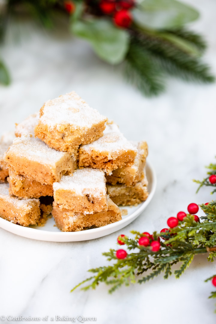 a plate of brown butter shortbread next to Christmas decorations