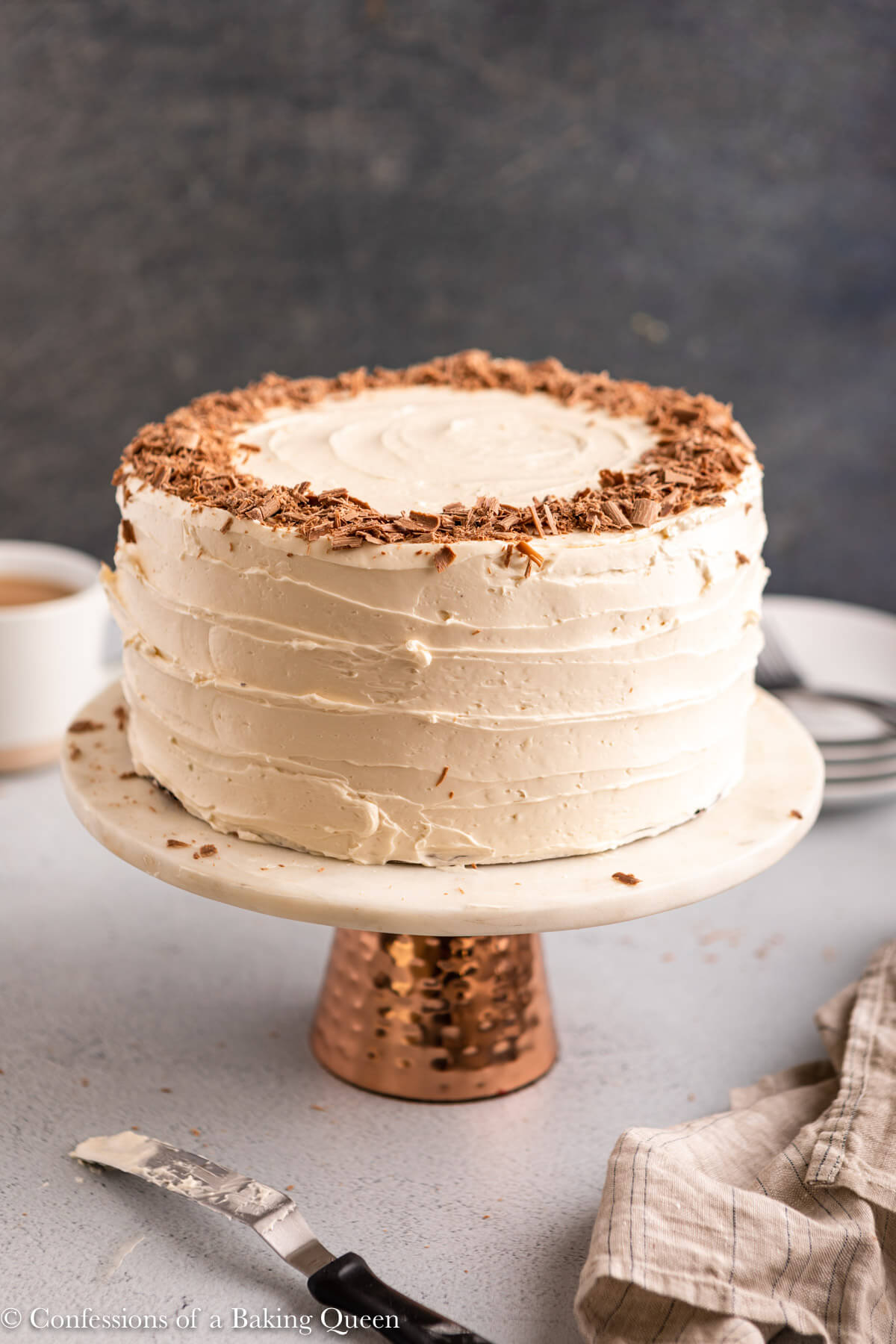 guinness chocolate cake frosted with baileys frosting on a cake stand