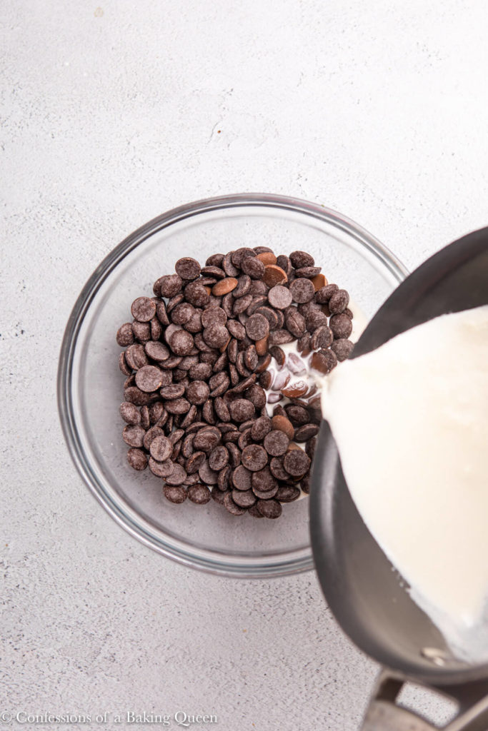 heavy cream poured into a bowl of chocolate