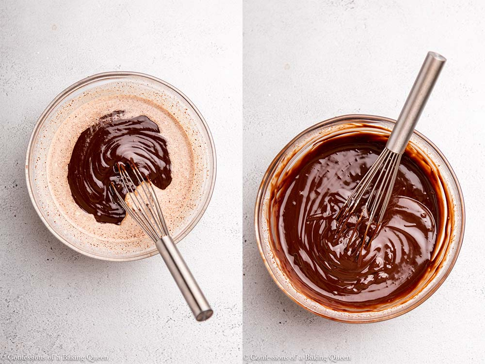 metal whisk in a glass bowl of chocolate ganache