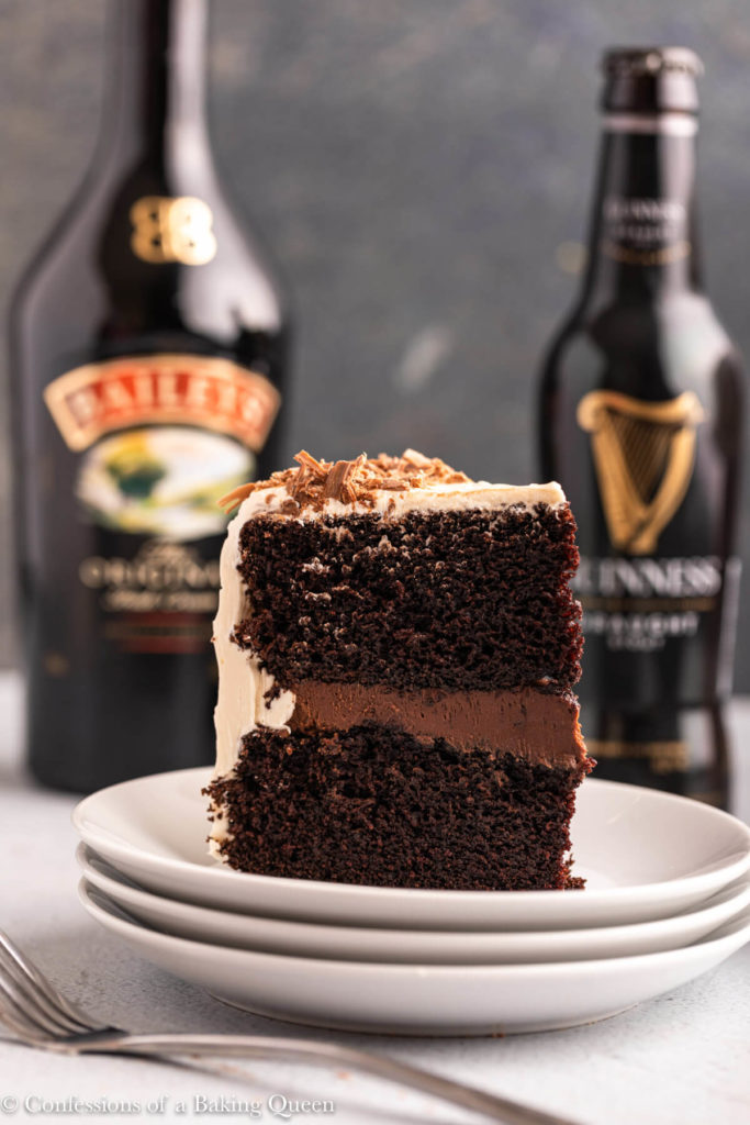slice of guinness chocolate cake next to a bottle of baileys and guinness