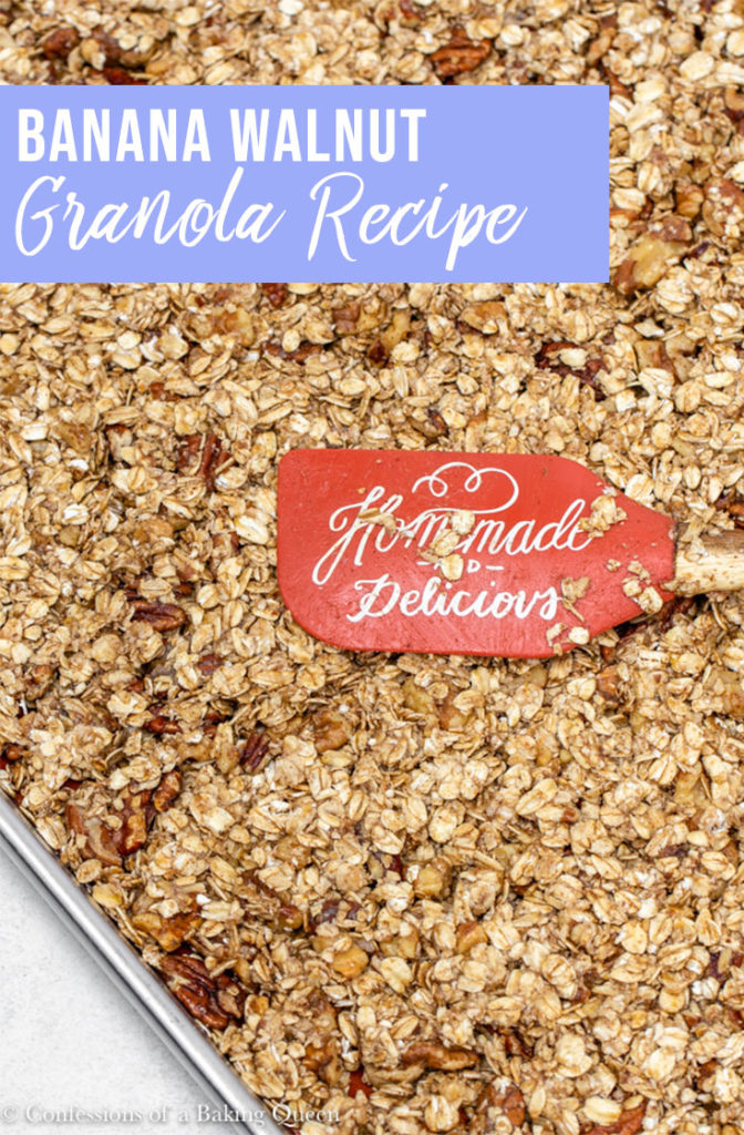 banana nut granola in a large sheet pan with an orange spatula on top