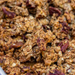 banana nut granola baked and cooled on a metal baking sheet lined with a silpat