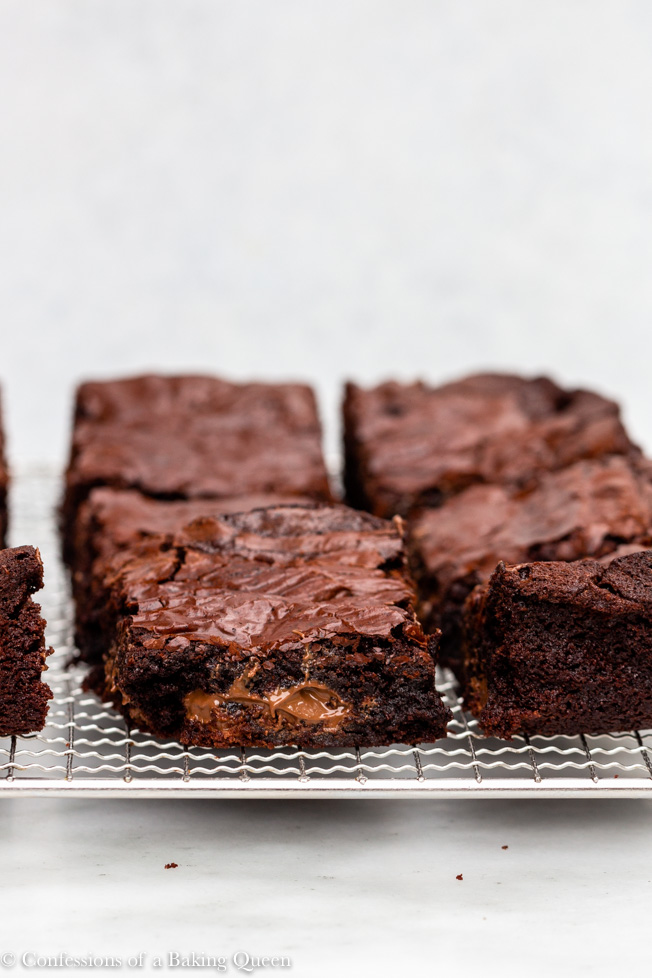 thick and chewy brownies baked and cooling on a wire rack