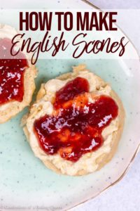english scones with clotted cream and jam on a blue plate