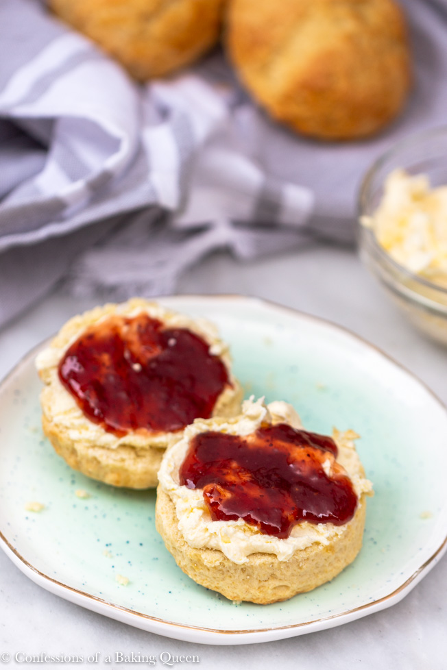 fresh baked sones with clotted cream and jam on
