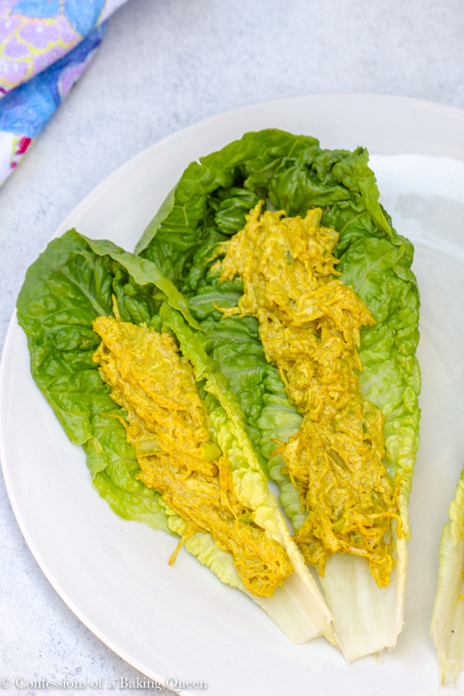 curried chicken salad recipe served on lettuce on a white plate