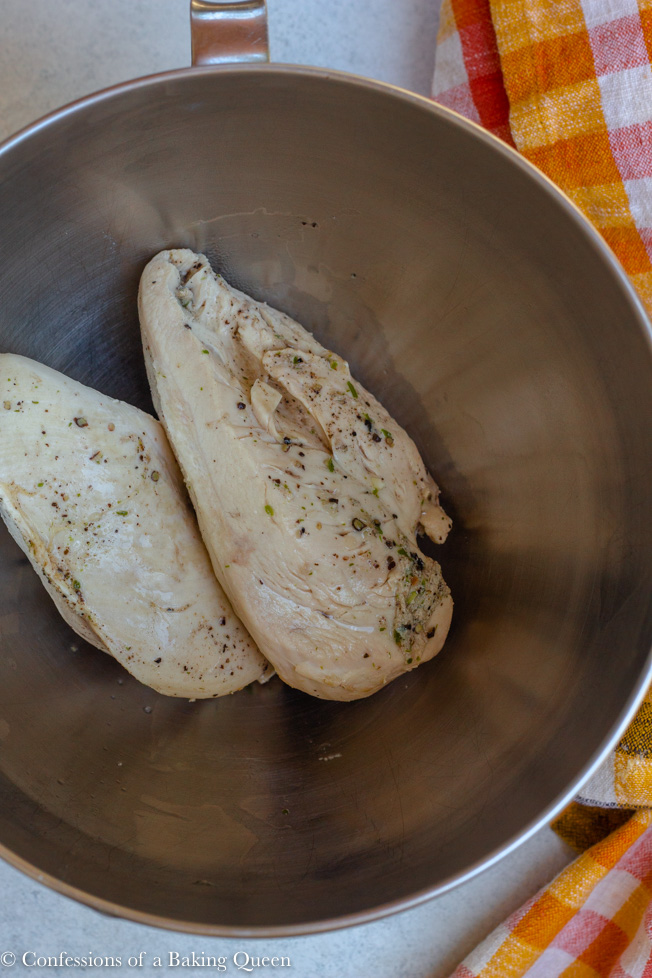 boiled chicken breasts in a silver bowl