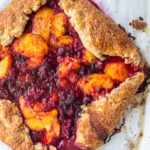 just baked Peach Raspberry Galette Recipe cooling on parchment paper