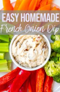 french onion dip in a white bowl next to colorful veggies