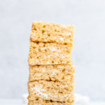 brown butter rice krispies stacked high with mini marshmallows next to the stack