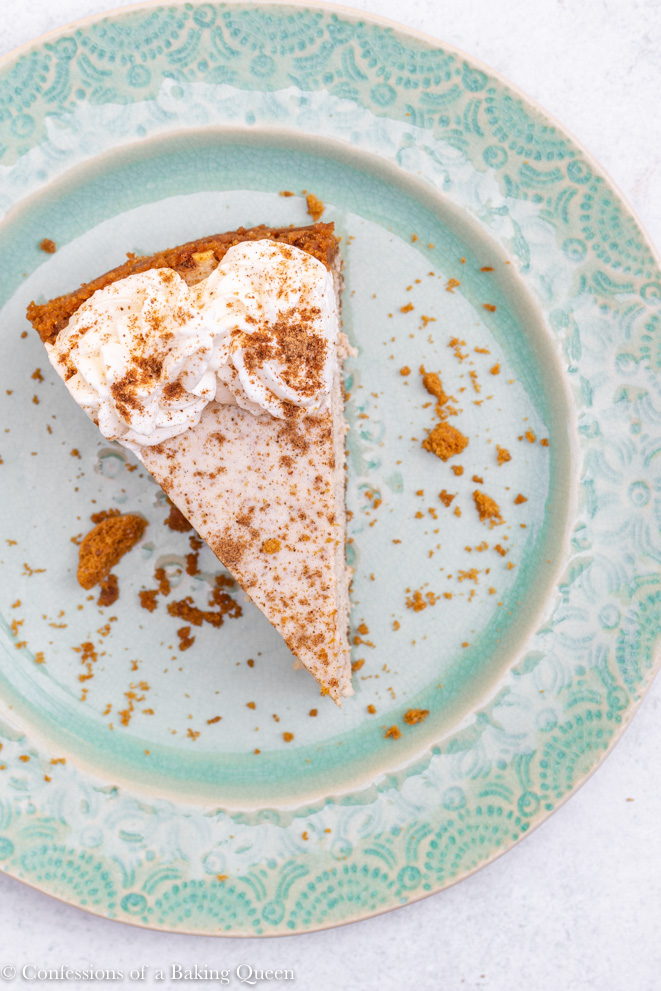 overhead shot of a chai cheesecake recipe on a teal plate