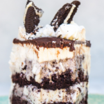 cookies and cream ice cream cake slice on a turquoise plate