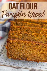oat flour pumpkin bread slices on a metal rack