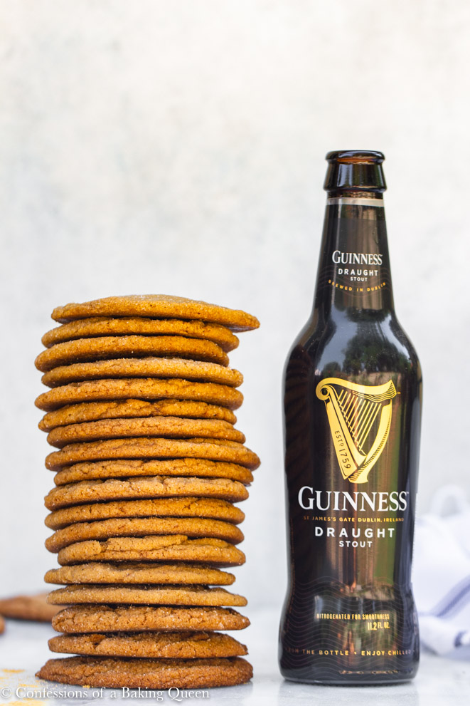 stack of guinness gingerbread cookies next to a bottle of guinness