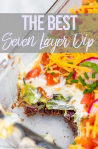 seven layer dip recipe in a glass container