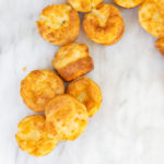 Yorkshire puddings in a snack like position on a white marble surface