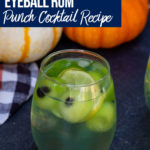 eyeball rum punch cocktail with pumpkins in the background