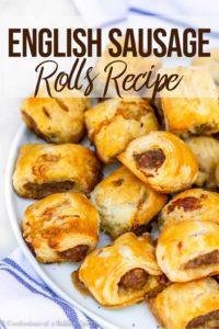 baked sausage rolls on a white plate
