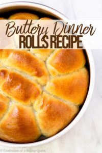 buttery yeasted dinner rolls in a round silver pan